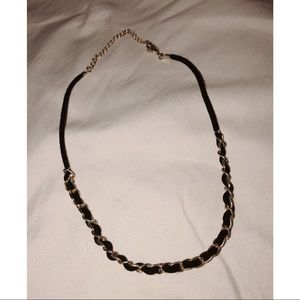 choker necklace with gold chains and black tie